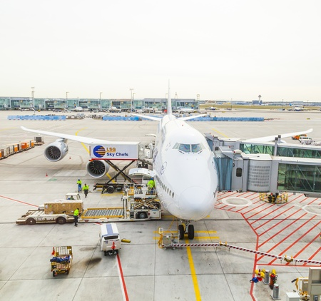 FRANKFURT, GERMANY - October 13: Lufthansa B747 800 airplane parked on Frankfurt airport while people are boarding to the flight to Delhi on October 13,2012 in Munich, Germany.