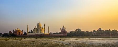 love dome: taj mahal from yamuna river in sunset