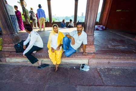 jama mashid: DELHI, INDIA - OCTOBER 16: A family of worshipers rest on the courtyard of Jama Masjid Mosque on October 16, 2012 in Delhi, India. Jama Masjid is the principal mosque of Old Delhi in India.