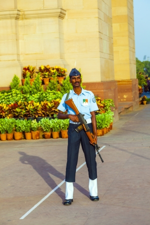 NEW DELHI - INDIA, OCT 16: soldier in parade uniform guards the indian gate with a gun in his hand on October 16,2012 in Delhi, India. India Gate was erected 1921 by Edwin Lutyens. Stock Photo - 16377516
