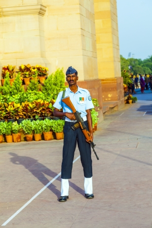 india gate: NEW DELHI - INDIA, OCT 16: soldier in parade uniform guards the indian gate with a gun in his hand on October 16,2012 in Delhi, India. India Gate was erected 1921 by Edwin Lutyens.