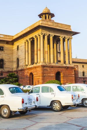 norms: DELHI, INDIA - OCTOBER 16: Official Hindustan Ambassador cars parked outside North Block, Secretariat Building, on October 16, 2012 in Delhi, India. The production started in 1958 on base of the Morris Oxford model. Editorial
