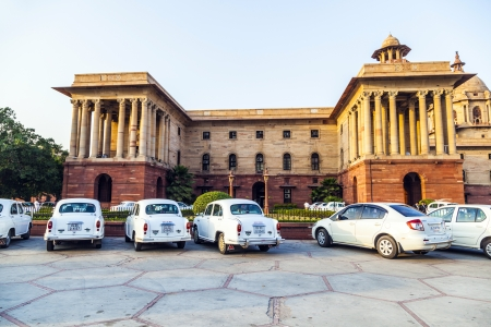 ambassador: DELHI, INDIA - OCTOBER 16: Official Hindustan Ambassador cars parked outside North Block, Secretariat Building, on October 16, 2012 in Delhi, India. The production started in 1958 on base of the Morris Oxford model. Editorial