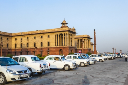 secretariat: DELHI, INDIA - OCTOBER 16: Official Hindustan Ambassador cars parked outside North Block, Secretariat Building, on October 16, 2012 in Delhi, India. The production started in 1958 on base of the Morris Oxford model. Editorial