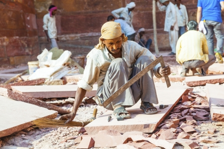 stone cutter: India: Agra Red Fort, a Unesco World Heritage site, and one of the biggest tourist highlights, just 2 km of Taj Mahal. Built by several Mughal emperors from XV to XVI centuries. Uttar Pradesh, India. Editorial