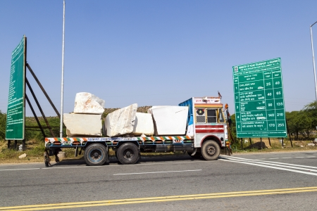 PADANGANJ, INDIA - OCTOBER 21: lorry transports huge marble stones from the pit on highway 7 to resellers all over india on October 21,2012 in Padanganj, india. Stock Photo - 16558481