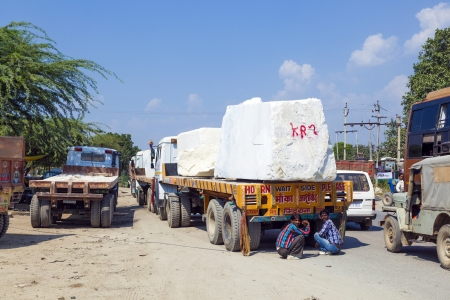 PADANGANJ, INDIA - OCTOBER 21: lorry transports huge marble stones from the pit on highway 7 to resellers all over india on October 21,2012 in Padanganj, india. Stock Photo - 16558491