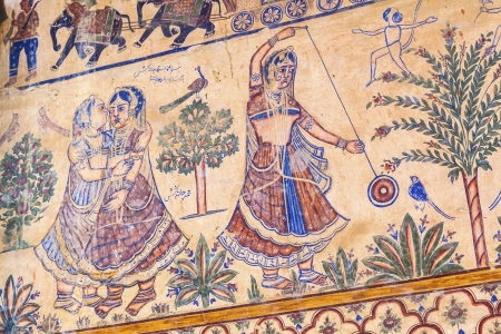 BIKANER, INDIA - OCT 24: Frescoed Havelis, traditional ornately decorated residences on October 24,2012 in Bikaner, India. The frescoes by gypsy painter show the traditional life of gypsies in India. Stock Photo - 16743252