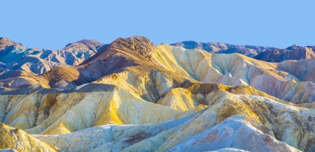 eroded: Picturesque soft waves from multi-coloured sandstone. Death valley, Zabriski - a point on a sunset