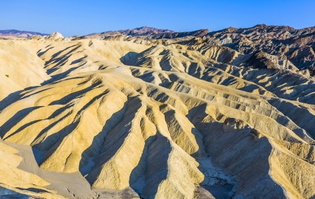 Picturesque soft waves from multi-coloured sandstone. Death valley, Zabriski - a point on a sunset Stock Photo - 16721622