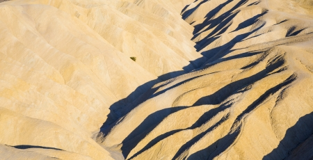 Picturesque soft waves from multi-coloured sandstone. Death valley, Zabriski - a point on a sunset photo