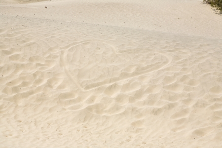 Mesquite Flats Sand Dunes in the northern point of the Dead valley in heat, made of fine quartz sand, a heart is painted in the sand Stock Photo - 16721608
