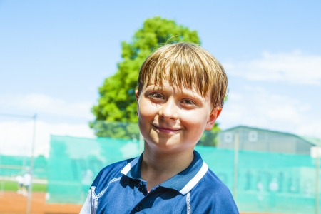child looks happy and satisfied after the tennis match Stock Photo - 16757158