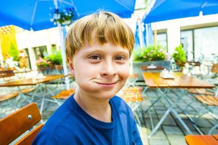 freising: happy smiling child enjoys eating Stock Photo