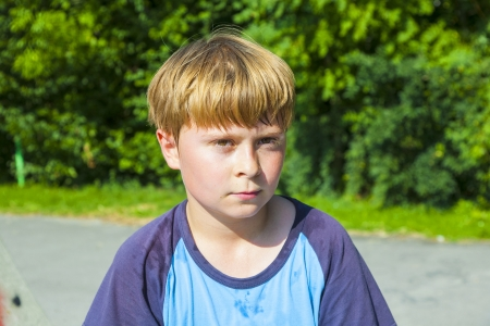 boy with sweating face after sport looks confident photo