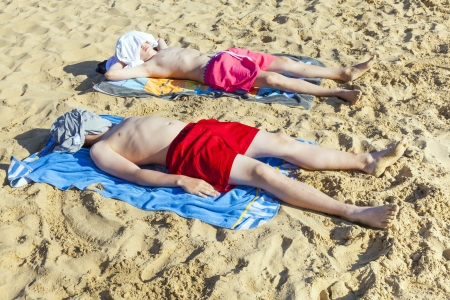 brothers relax and sleep at the beach Stock Photo - 16826456