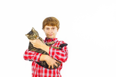 happy boy with his cat in the arm Stock Photo - 16826463