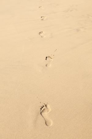 human footsteps at the clean sandy beach photo