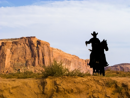 cowboy silhouette at John Fords Point in Monument valley Stock Photo - 16923206