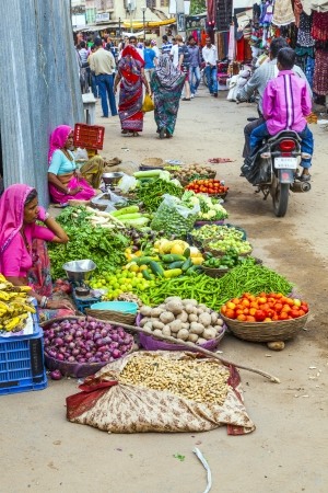 PUSHKAR, INDIA -OCTOBER 20: Unidentified vendors sell goods in a vegetable street market on Oct. 20,2012 in Pushkar, India. Agricultural sector makes up 18.1% of GDP. India is the biggest producer of fruits and second for vegetables.