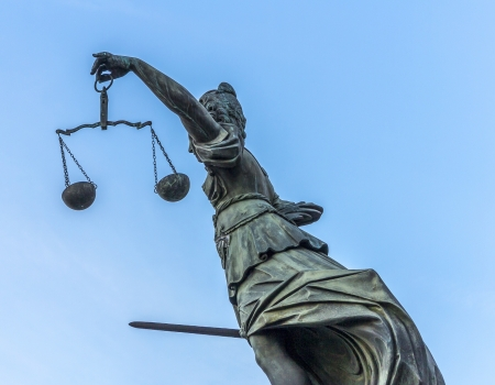 famous lady justice in Frankfurt under blue sky photo
