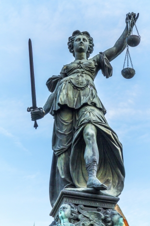 lady justice: famous lady justice in Frankfurt under blue sky