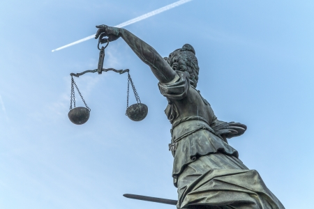 famous lady justice in Frankfurt under blue sky Stock Photo - 16930348