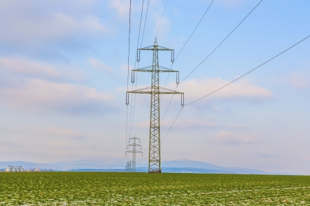 acres with snow in winter in beautiful light with electricity tower photo