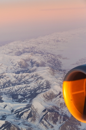 beautiful view from the aircraft to the mountains in Tashkent, china and Kirgistan and aircraft turbine engine