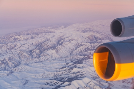 beautiful view from the aircraft to the mountains in Tashkent, china and Kirgistan and aircraft turbine engine Stock Photo - 16953942