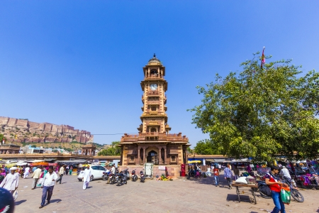 clocktower: JODHPUR, INDIA - OCTOBER 23: people hurry at the Sadar market at the clocktower on October 23,2012 in Jodhpur, India. The imposing Clock Tower was built by Maharaja Sardar Singh (1880-1911).