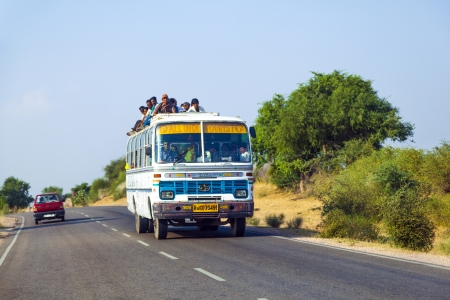 unsatisfactory: JODHPUR, INDIA - 23 OCTOBER: people travel by bus in Jodhpur on October 23, 2012. Unsatisfactory quantity & quality of public transportation limit indian people in everyday traveling.