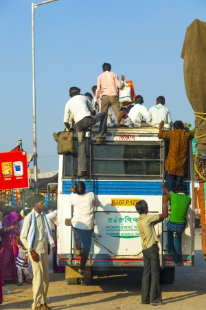 everyday people: JODHPUR, INDIA - 23 OCTOBER: people travel by bus in Jodhpur on October 23, 2012. Unsatisfactory quantity & quality of public transportation limit indian people in everyday traveling.