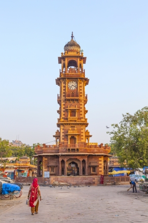 clocktower: JODHPUR, INDIA - OCTOBER 23: people hurry at the Sadar market at the clocktower on October 23,2012 in Jodhpur, India. The imposing Clock Tower was built by Maharaja Sardar Singh (1880-1911) from whom the market takes it name.
