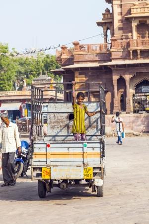 maharaja: JODHPUR, INDIA - OCTOBER 23: people on a lorry at the Sadar market at the clocktower on October 23,2012 in Jodhpur, India. The imposing Clock Tower was built by Maharaja Sardar Singh (1880-1911).