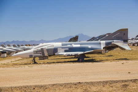 TUCSON, USA - JULY 14: view of old fighter aircraft at Montham AFB at July 14, 2012 in Tucson, USA. The aircrafts don't rust in that dry area. It is a big  aircraft parking garage for civil and military aircrafts. Stock Photo - 16979067