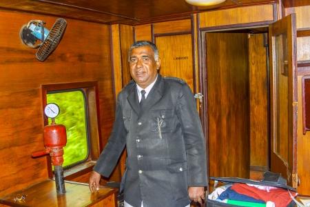 public servants: NUWARELIA, SRI LANKA - AUG 16: proud conductor in train from Nuwarelia to Colombo on August 16,2005, Nuwarelia, Sri Lanka, This route was first operated on 20 March 1885.