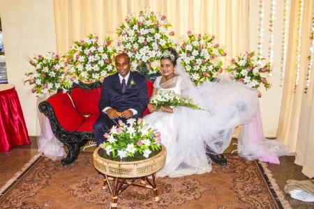 COLOMBO, SRI LANKA - AUG 18: happy fresh married couple poses for tourists and Photographers at a big wedding ceremony on AUG 16, 2005 in Colombo, Sri Lanka. Stock Photo - 17025738