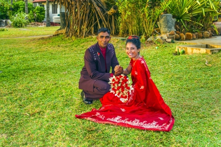 COLOMBO, SRI LANKA - AUG 18: happy fresh married couple poses for tourists and Photographers at a big wedding ceremony on AUG 16, 2005 in Colombo, Sri Lanka. Stock Photo - 17025753