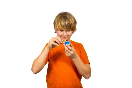 boy likes to play with matches and a candle Stock Photo - 17047942