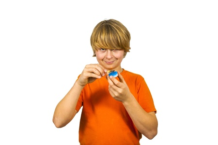 boy likes to play with matches and a candle Stock Photo - 17047936