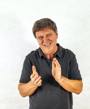 Portrait of a stylish  man standing and gesturing with his hands Stock Photo - 17054192