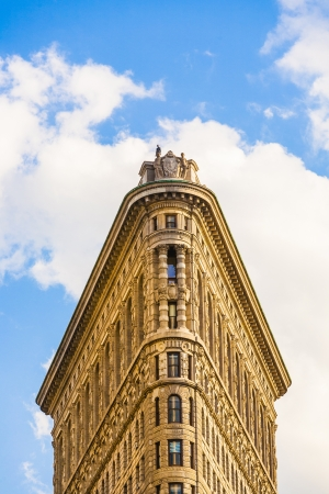 NEW YORK CITY – JULY 12: Facade of the Flatiron building  with iron statue of Man on the roof on July 12,2010 in New York City.