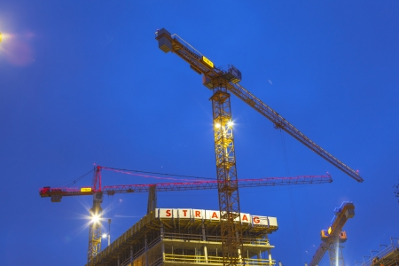 reeperbahn: HAMBURG, GERMANY - JANUARY 20: at the construction site at the Reeperbahn in Hamburg they work 24 hours daily to finalize the new skyscraper on Jan 20, 2011 in Hamburg, Germany.