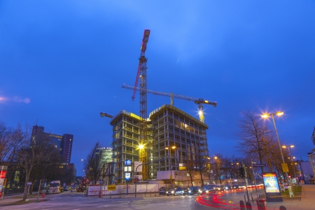 reeperbahn: HAMBURG, GERMANY - JANUARY 20: at the construction site at the Reeperbahn in Hamburg they work 24 hours daily to finalize the new skyscraper on Jan 20, 2011 in Hamburg, Germany.