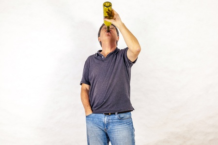mature man drinks alcohol out of a bottle Stock Photo - 17076874