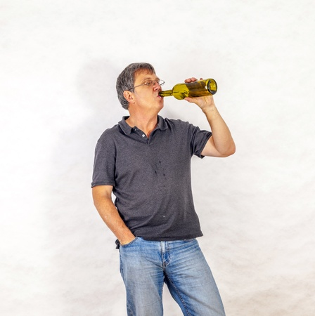 mature man drinks alcohol out of a bottle Stock Photo - 17076838