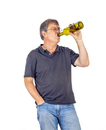 mature man drinks alcohol out of a bottle Stock Photo - 17076902