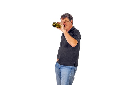 mature man drinks alcohol out of a bottle Stock Photo - 17076911
