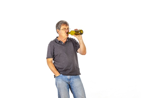 mature man drinks alcohol out of a bottle Stock Photo - 17076897